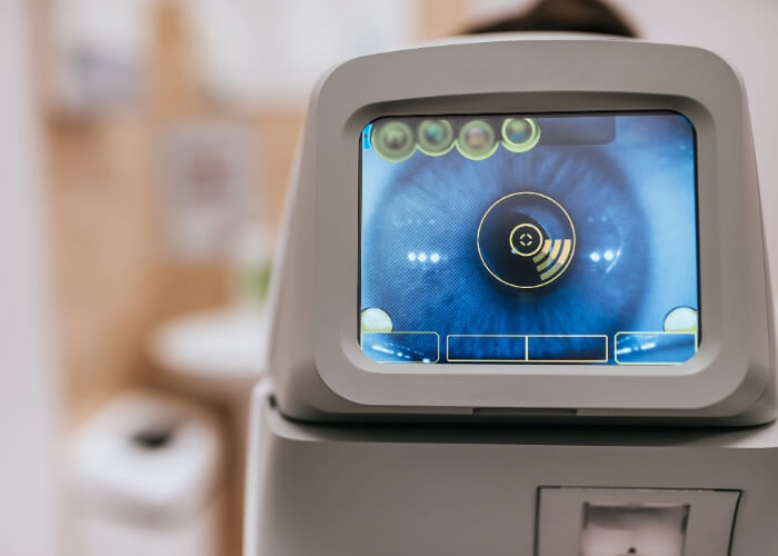 Optical machine with a close-up of an eye on the screen